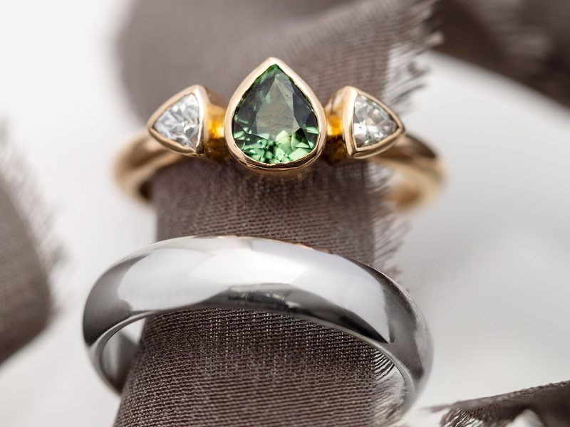 Green and white sapphires engagement ring